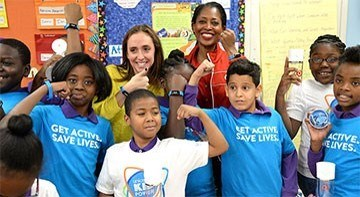 Target's Laysha Ward joins kids at a UNICEF Kid Power school program event.