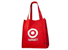 A red reusable tote bag with Target Bullseye logo in white text.