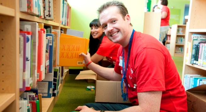team members shelving new books in a school library