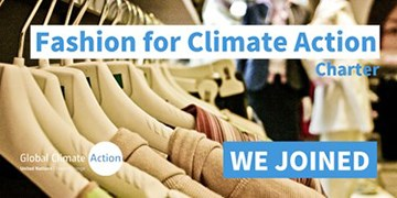 Clothing on hangers with text that reads Fashion for Climate Action Charter: We Joined