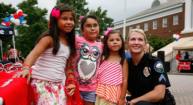 community members pose during a National Night Out event