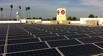 solar panels atop a roof of a Target store provide the store with power