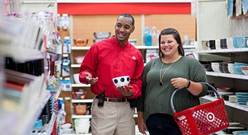a Target team member helps a guest at a store