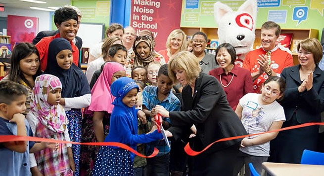 Children cut the ribbon to their new library funded through Target donations