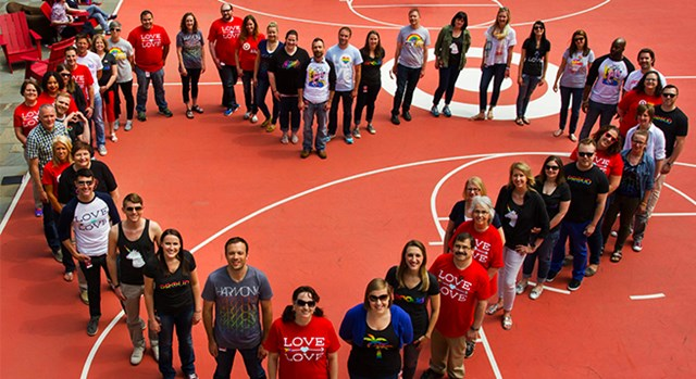 Members of Target's LGBTA Business Council standing in the shape of a heart