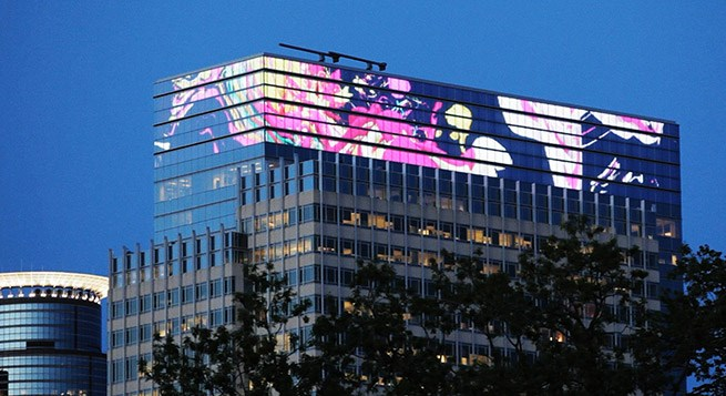 Artist Seidel, shown on the largest LED display in the Midwest, atop a downtown Target office tower.