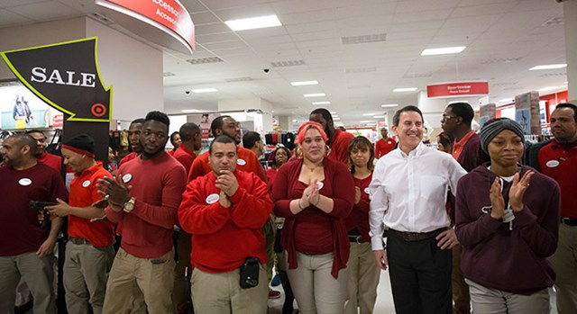 Target CEO Brian Cornell and Target team members greet shoppers in a Target store on Black Friday