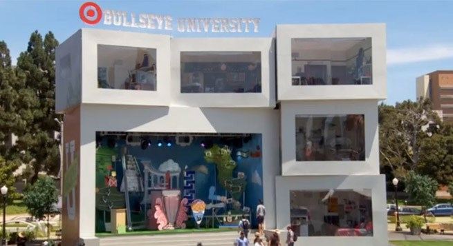 Guests stand outside the Bullseye University dorms and watch the interactive experience live.