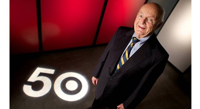 Doug Dayton stands next to a 50 in celebration of Target's 50th anniversary.