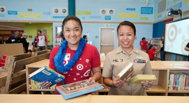 A Target team member and veteran from The Mission Continues shelve books together