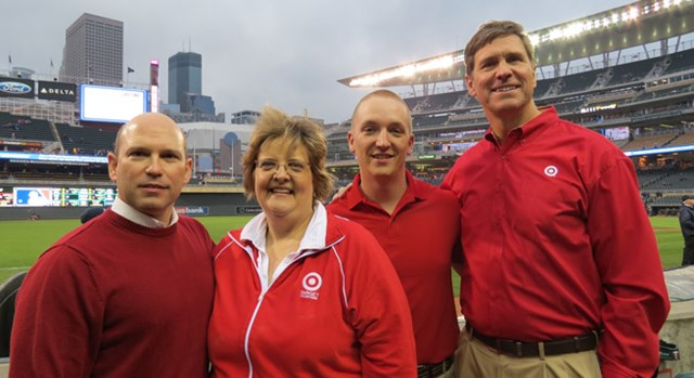 Team members represent Target on the field during a pre-game ceremony.