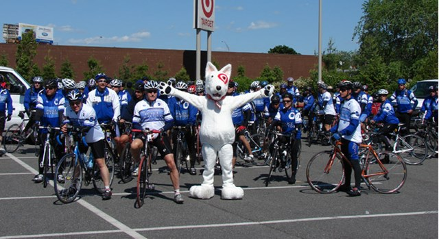 Police on bikes pose with a Bullseye mascot in celebration of Police Week.