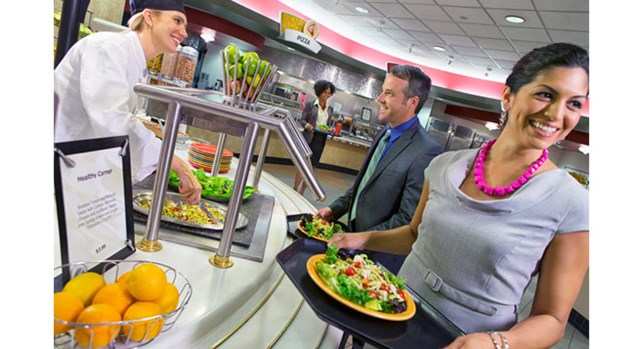 "Team members wait in the for a meal from the ""Healthy Corner"" station at Target headquarter's cafe."