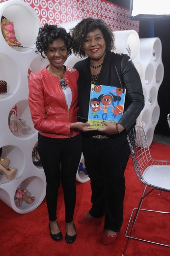 Patrice Yursik, creator of Afrobella.com, and author Chental-Song Bembry pose on the red carpet