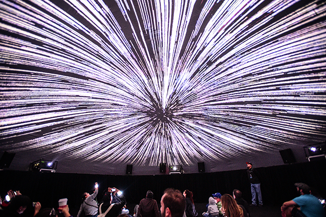 Visitors Watch A Light Show Projected On The Domeu0027s Ceiling.