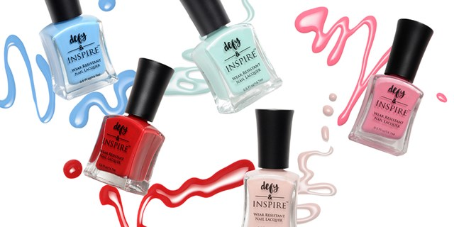 defy & Inspire nail polish in various colors over polish splatter background