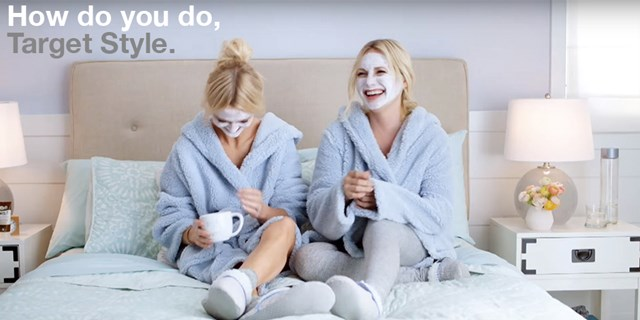 Zanna Roberts Rassi and Emily Henderson with face masks and robes in bed