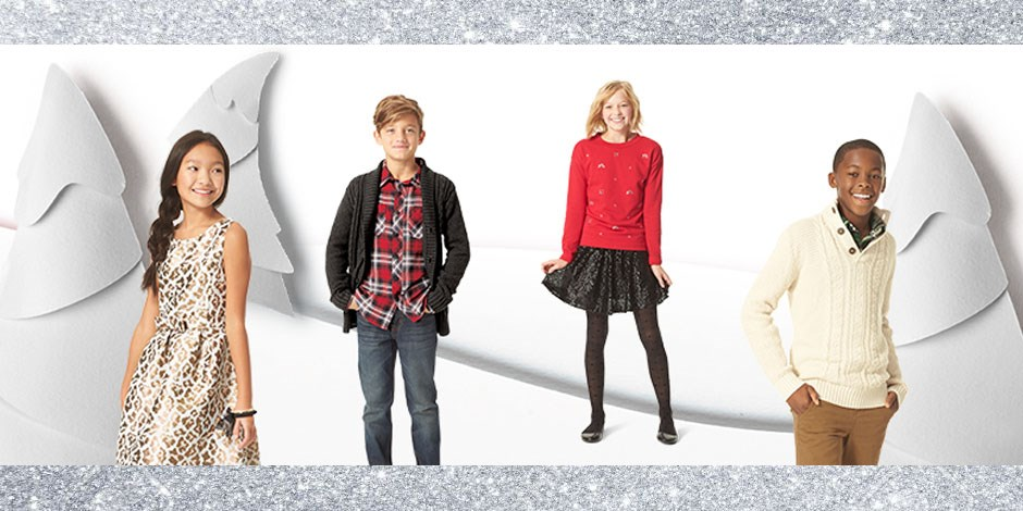 Four kids in front of winter and sparkle background with holiday outfits
