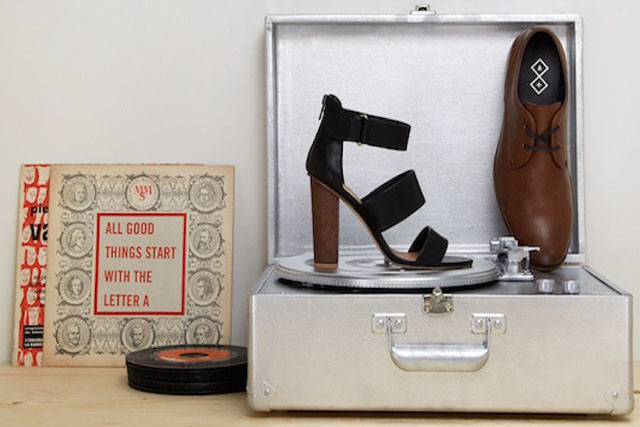 Two styles of shoes on a record player.