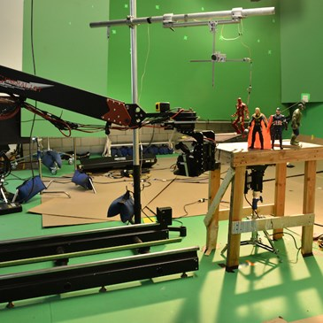 Behind the scenes photo of the avengers action figures and the commercial equipment