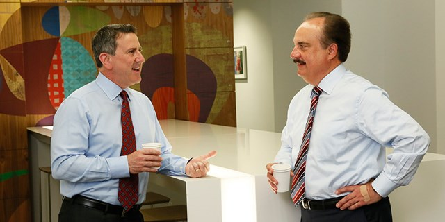 Target CEO Brian Cornerll talks with CVS Health President and CEO Larry Merlo