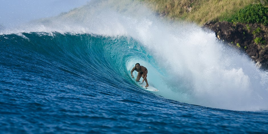 Pro Surfer Carissa Moore riding a wave
