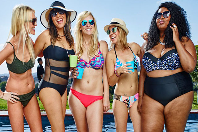 Five models dressed in Target swimwear and accessories.
