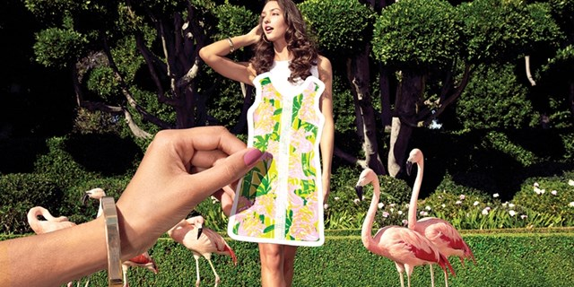 Paper Doll Header with Hand holding up Paper Lilly Pulitzer Dress to Model