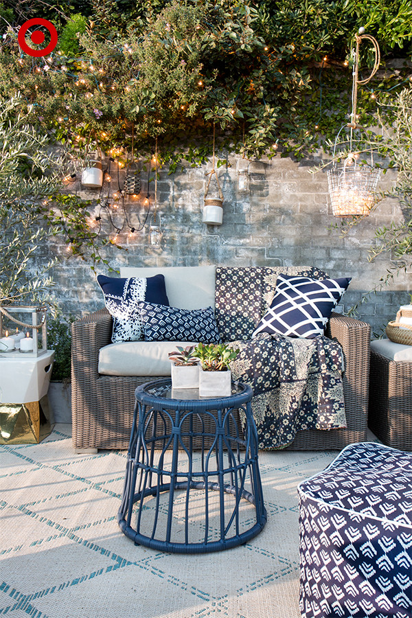 Layered printed pillows in a decorated outdoor space - Patio Pizzazz: Emily Henderson's Décor Tips For Outdoor Spaces