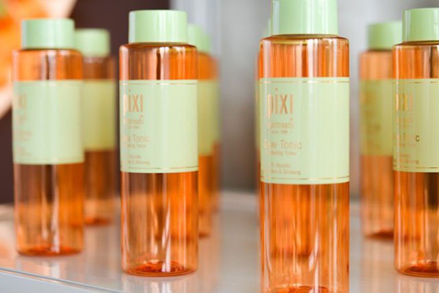 Bottles of Glow Tonic on a shelf.