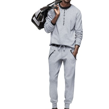 OAdam Lippes for Target henley, joggers and weekender bag on model