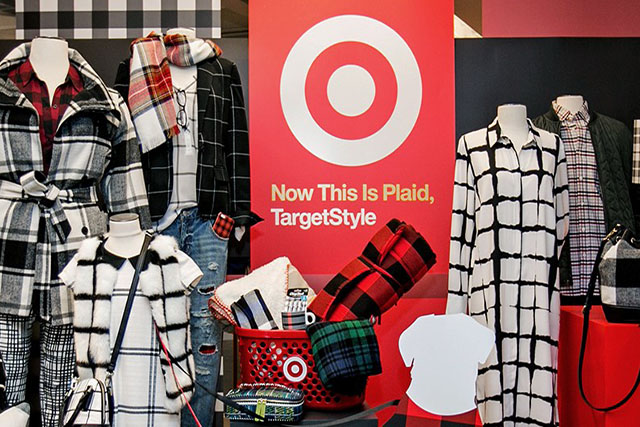 A display of several plaid products, including apparel on mannequins, bags and decor.