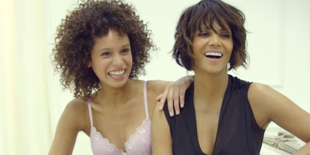 Halle Berry poses with a Scandale model