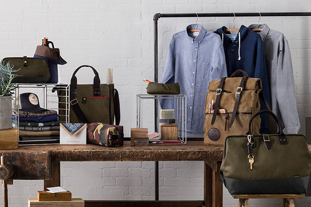 A vignette of men's bags, apparel and accessories.