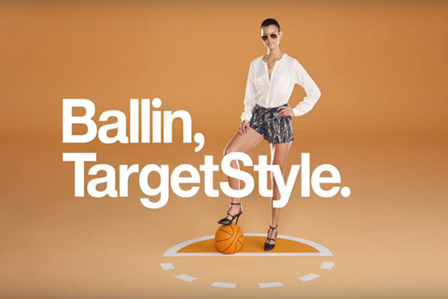 "Model in sunglasses with her foot on a basketball next to white text: ""Ballin', Target Style."