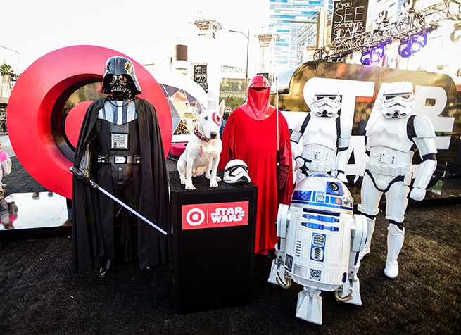 Darth Vader, Bullseye, an Imperial Guard and two Stormtroopers in front of event sign