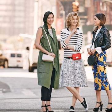 Group of models standing in the street wearing Who What Wear collection