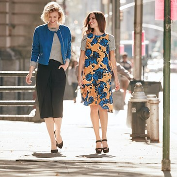 Model (L) wearing blue jacket black cullotes + model (R) wearing blue and yellow dress