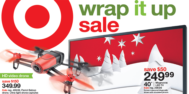 Front cover of the Wrap it Up Sale ad featuring a TV and a drone