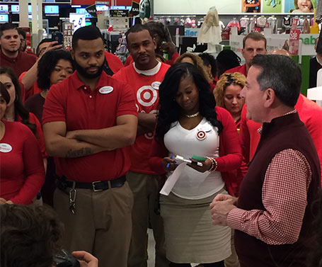 Brian Cornell speaks as the Jersey City store team looks on from the huddle