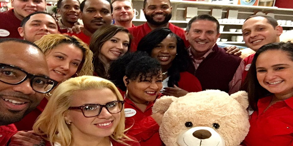 CEO Brian Cornell takes a selfie with team members at the Jersey City Target store