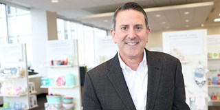 Target CEO Brian Cornell in front of merchandise displays