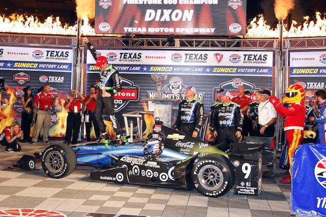 Scott Dixon celebrates after winning Firestone 600