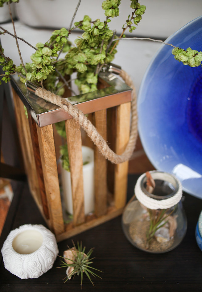 Succulents in jars and candles inside wooden lanterns