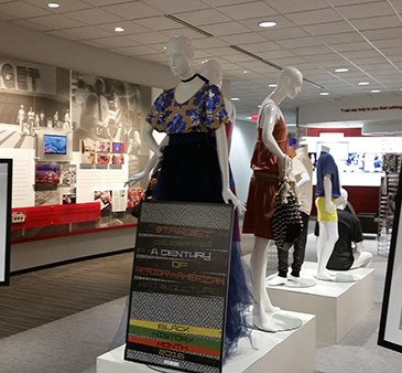 The front of the exhibit, featuring two photographs and mannequins in Target apparel