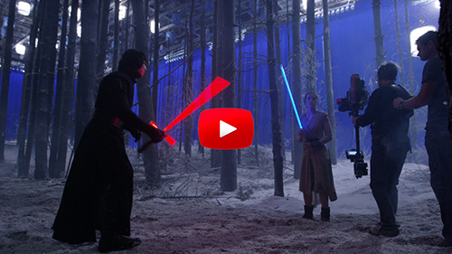 Characters with lightsabers on the set of The Force Awakens.