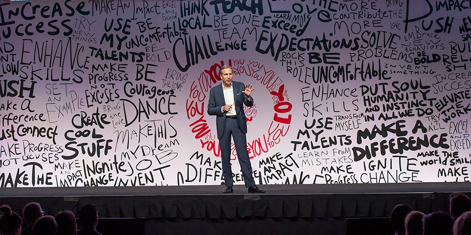Starbucks CEO Howard Schultz speaks onstage in front of the Target team.
