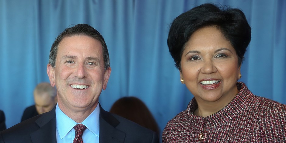 Brian Cornell (L) and Indra Nooyi (R) at an event