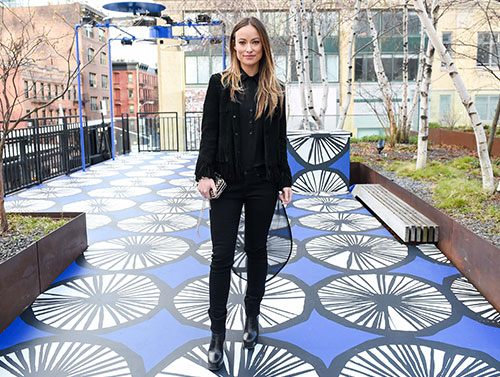 Actress Olivia Wilde poses on one of the Marimekko for Target installations on the High Line in New York City