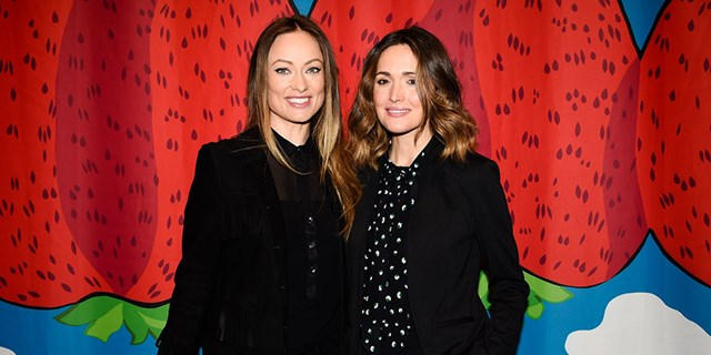 Actresses Olivia Wilde and Rose Byrne pose in front of a Marimekko for Target print In NYC